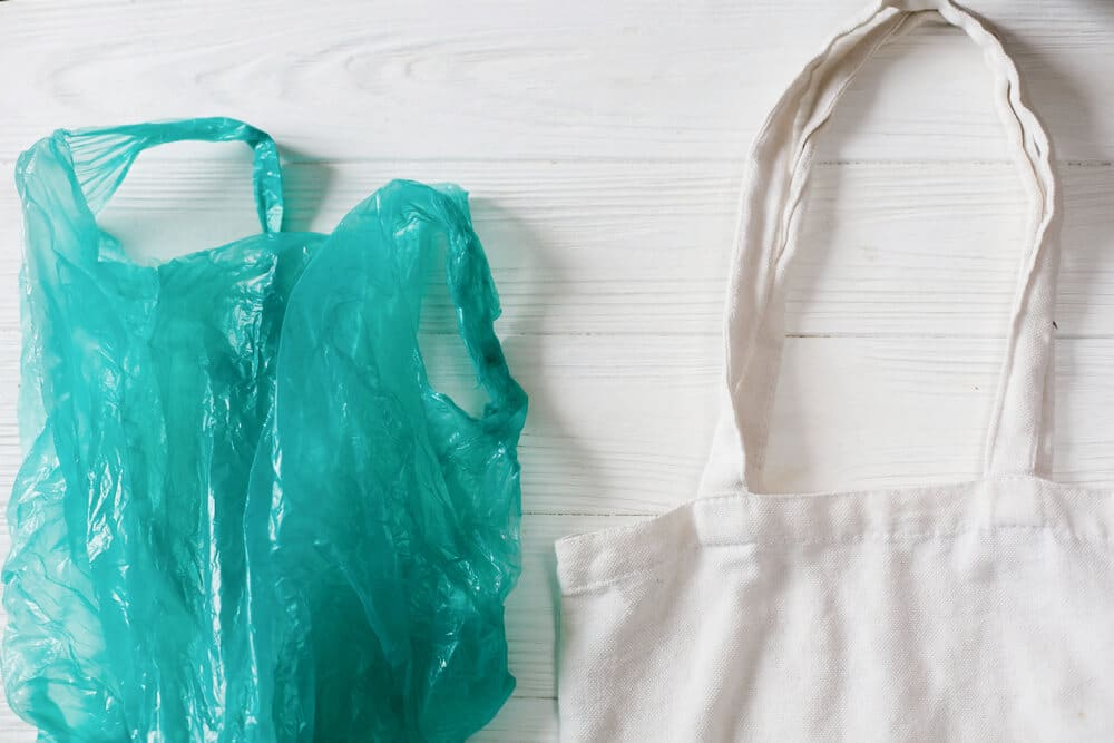the retail industry is switching from plastic bags to reusable tote bags to reduce waste