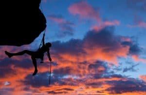 Mountain climber climbs with determination
