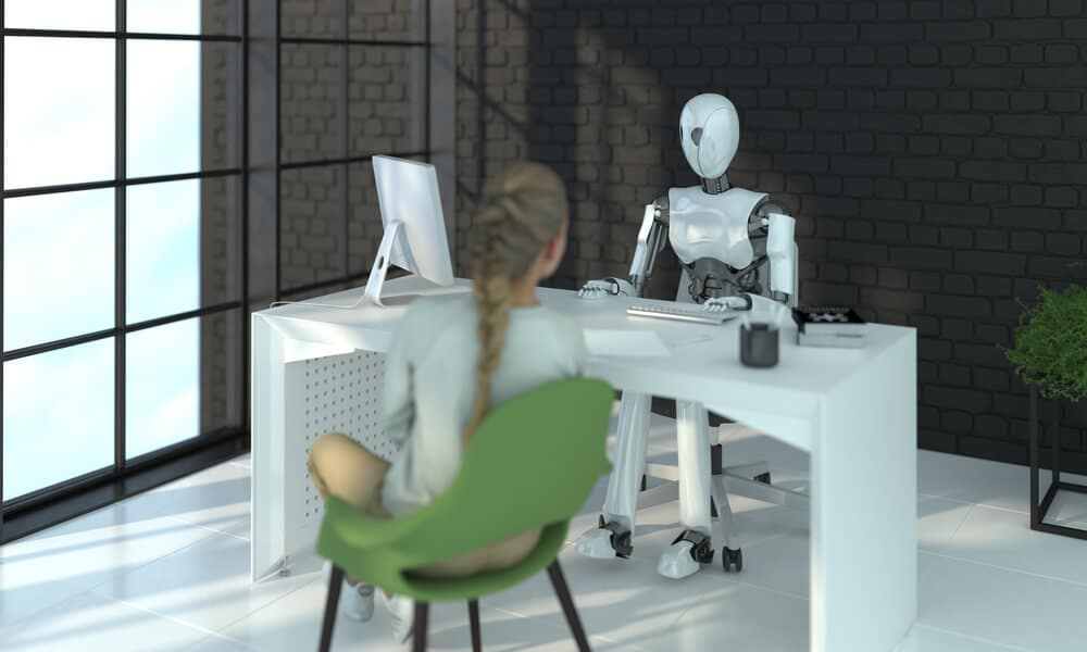 A robot is interviewing a woman