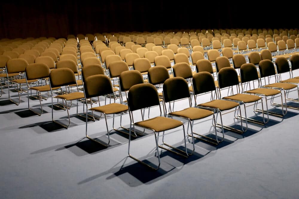 conference hall with empty chairs and no audience