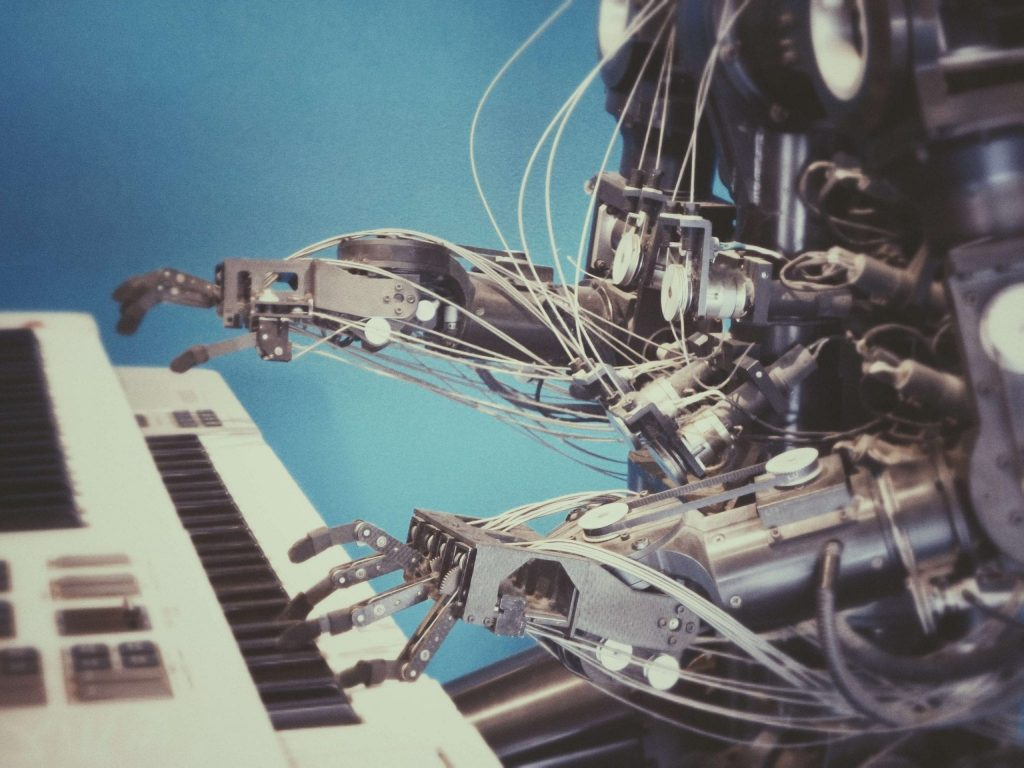 robot playing a piano is another example of how artificial intelligence can replace humans
