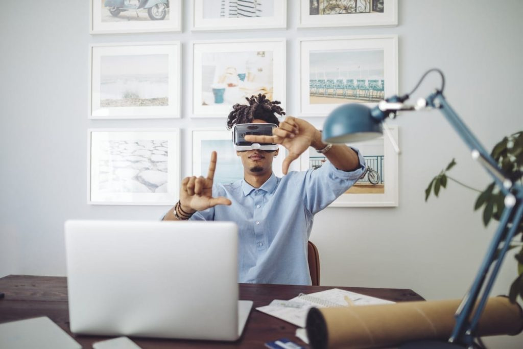 Generation Z man working from home with VR technology