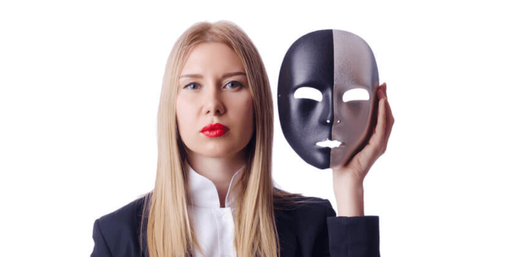 Business woman with a mask symbolizing the concept of imposter syndrome at work.