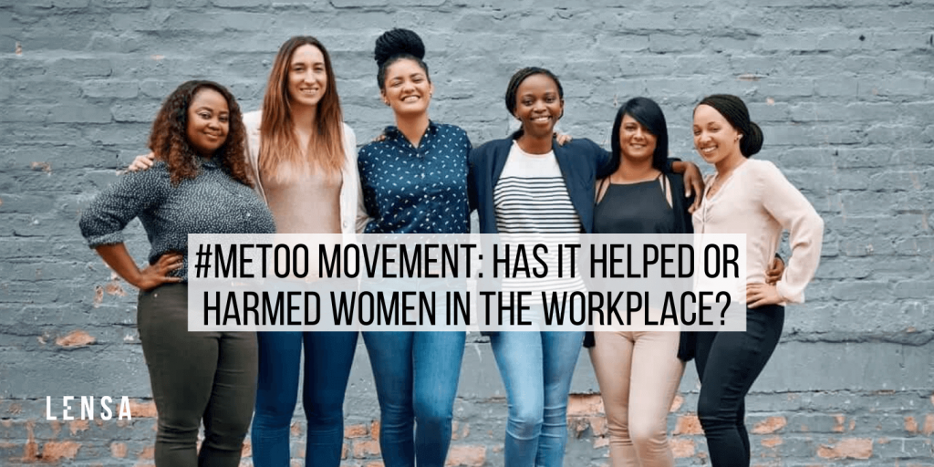 diverse group of women in smart casual attire standing in front of a gray wall in support of the #meetoo movement in the workplace