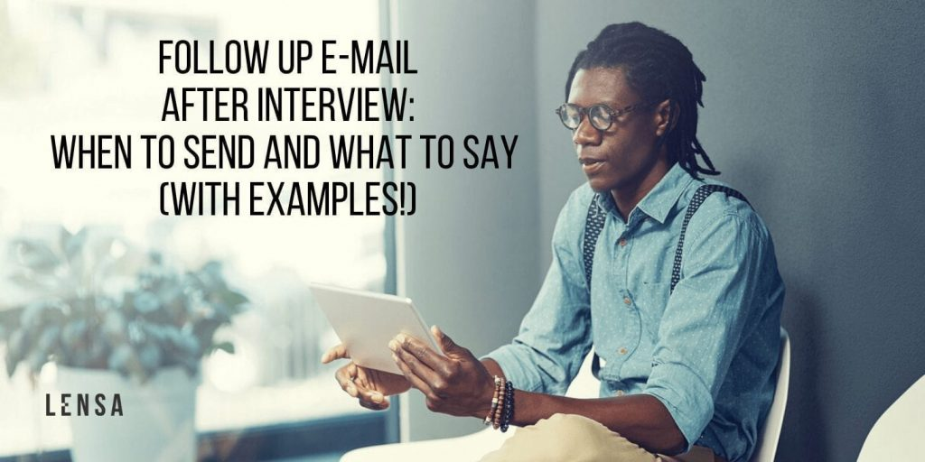 A black man writing a follow up e-mail after an interview on a tablet