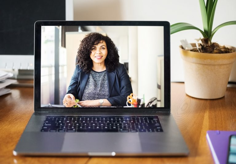 hiring manager interviewing a candidate through a video conference app