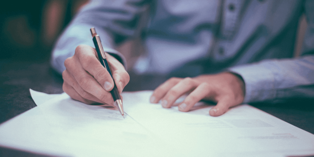 Worker signing an employer contract