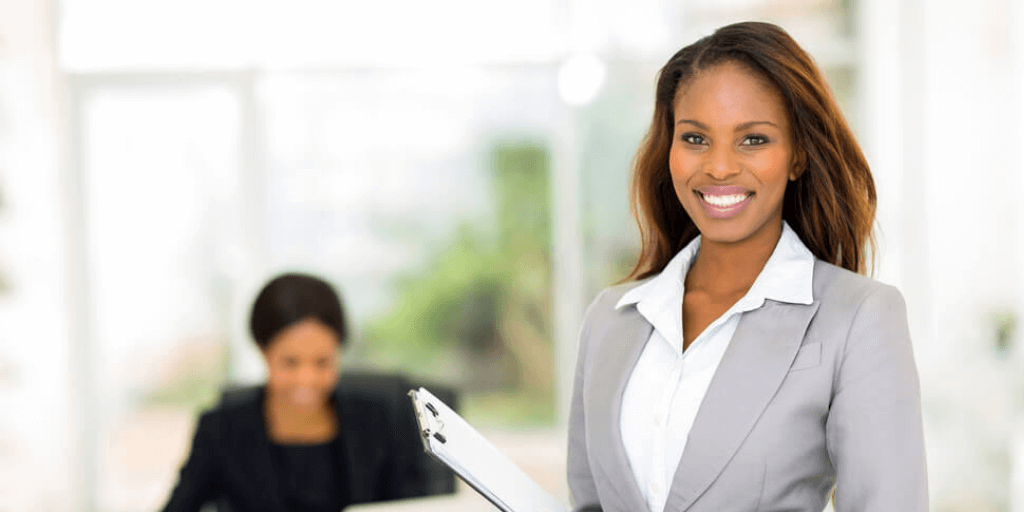 african-american woman employee standing confidently after successfully negotiating a raise