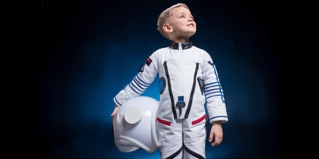 Little boy in a space suit visualizing his astronaut dream job