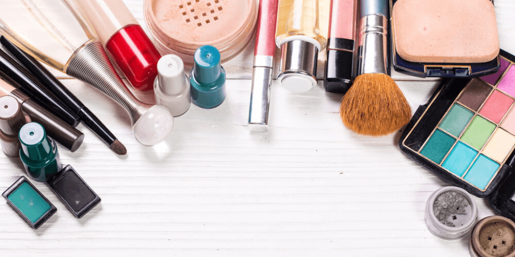 A variety of products and tools used in the makeup industry on a white table
