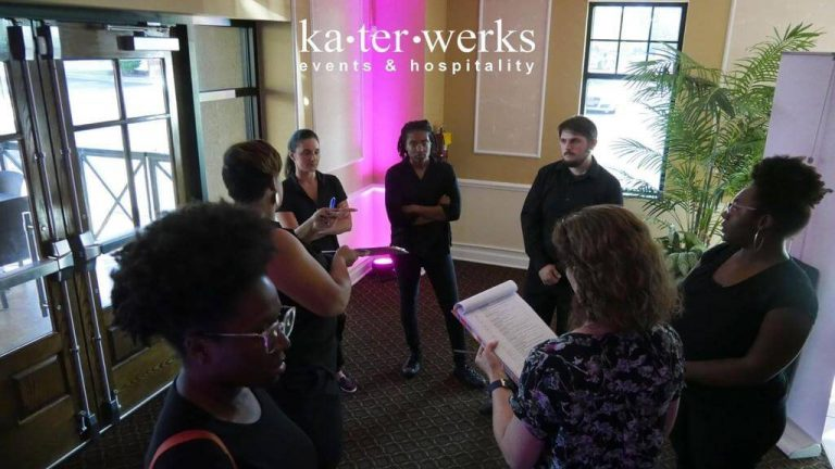 Katerworks stand-up meeting at a restaurant before an event