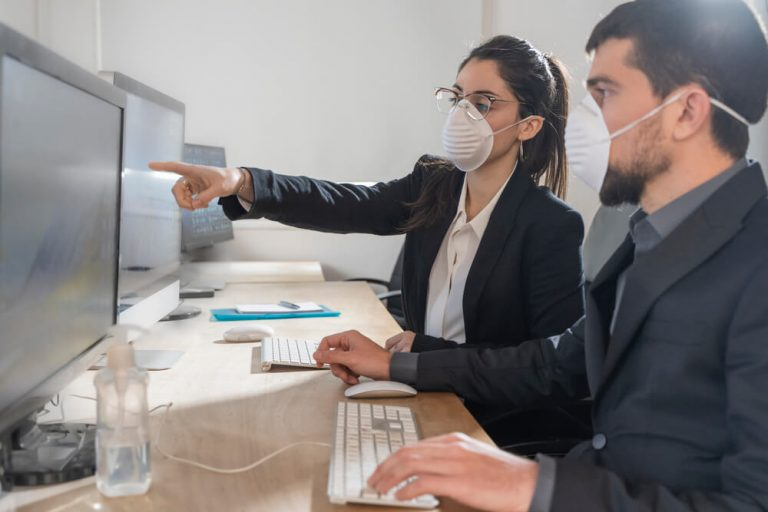 Employees wearing masks during COVID-19.