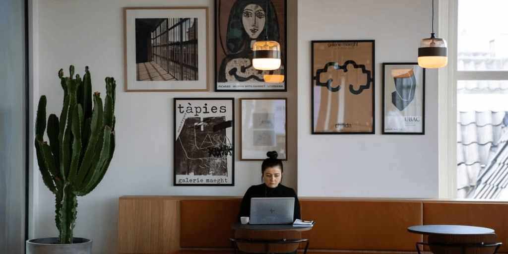 A woman sitting at a coffee shop searching for jobs.
