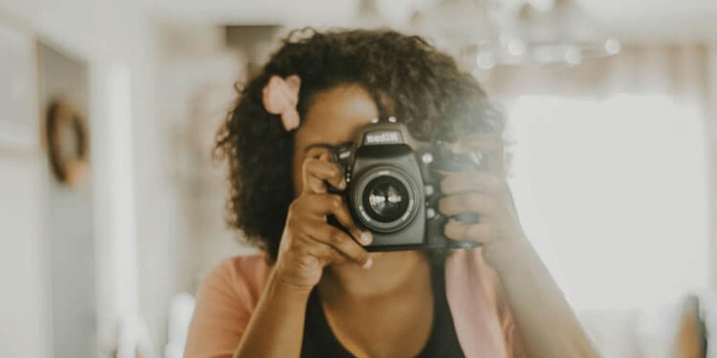 A woman enjoying her polaroid camera.